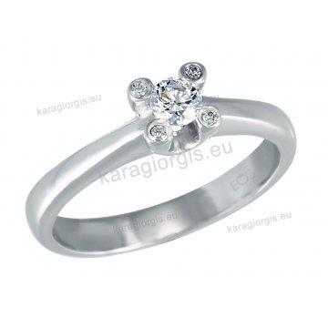 Μονόπετρο δαχτυλίδι Brilliand σε λευκόχρυσο 18Κ σε απλό δέσιμο με τέσσερα μικρά Brilliand πάνω στη βάση 0,20ct σε VS ποιότητα και G χρωματισμό