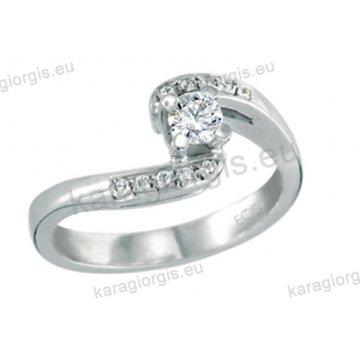 Μονόπετρο δαχτυλίδι Brilliand σε λευκόχρυσο 18Κ σε τετράγωνο δέσιμο τεσσάρων σημείων τύπου φλόγας 0,30ct & με brilliand στα πλαϊνά 0,10ct σε VS ποιότητα και G χρωματισμό