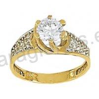 Μονόπετρο δαχτυλίδι δίχρωμο χρυσό με λευκόχρυσο σε σχήμα αστεριού με άσπρες πέτρες ζιργκόν στα πλαϊνά