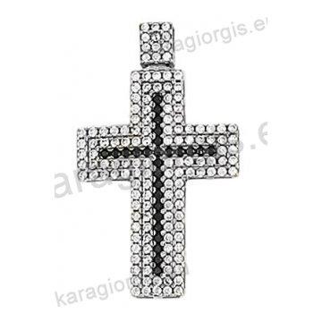 Βαπτιστικός σταυρός λευκόχρυσος Κ14 με άσπρες και μαύρες πέτρες ζιργκόν