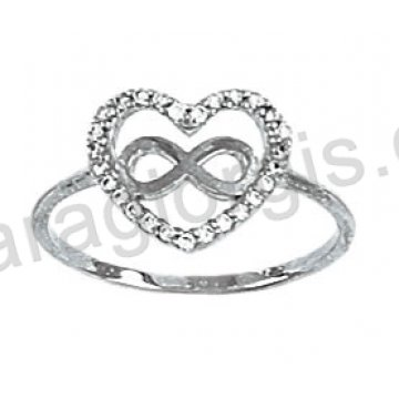 Μοντέρνο λευκόχρυσο δαχτυλίδι Κ14 σε σχήμα καρδιάς και το σύμβολο άπειρο με άσπρες πέτρες ζιργκόν