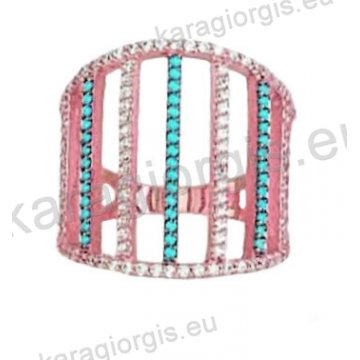 Μοντέρνο δαχτυλίδι σε ροζ χρυσό Κ14 με ένθετο λευκόχρυσο με άσπρες και γαλάζιες πέτρες ζιργκόν.
