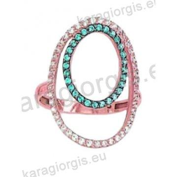 Μοντέρνο δαχτυλίδι σε ροζ χρυσό Κ14 με ένθετο λευκόχρυσο με άσπρες και γαλάζιες πέτρες ζιργκόν σε μαύρο χρυσό.