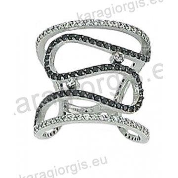 Δαχτυλίδι λευκόχρυσο Κ14 μοντέρνο με άσπρες και μαύρες πέτρες ζιργκόν. 682d641e6d2