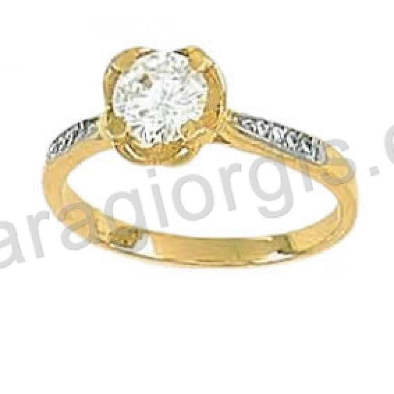 Μονόπετρο δαχτυλίδι χρυσό Κ14 σε αμερικάνικο τύπο με πέτρα στο κέντρο και  πλαϊνές πέτρες ζιργκόν. 3889719dc4b