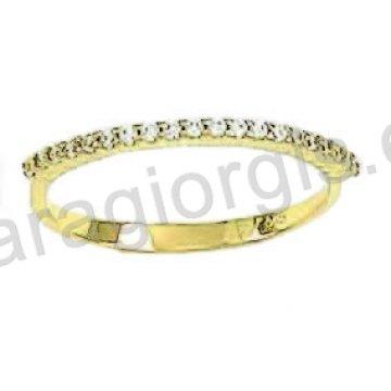 Δαχτυλίδι χρυσό Κ14 σε σειρέ με άσπρες πέτρες ζιργκόν.