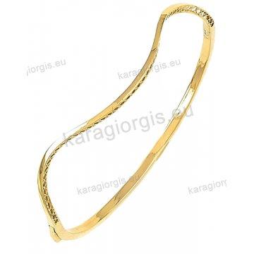 Βραχιόλι χρυσό Κ14 σε βέργα έκκεντρο με λουστρέ φινίρισμα.