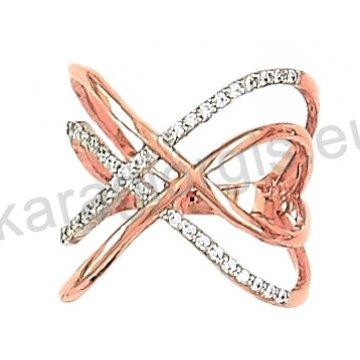 Δαχτυλίδι rose gold σε ροζ χρυσό Κ14 με άσπρες πέτρες ζιργκόν σε σχήμα χιαστί.