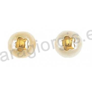 Σκουλαρίκι χρυσό σε μονόπετρο Κ14 με άσπρη πέρλα και ένθετο λουλουδάκι.