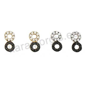 Σκουλαρίκι χρυσό ή λευκόχρυσο Κ14 με μαύρες και άσπρες πέτρες ζιργκόν.