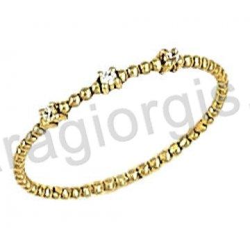 Δαχτυλίδι χρυσό 14 καράτια σειρέ σε στριφτό με άσπρες πέτρες ζιργκόν.