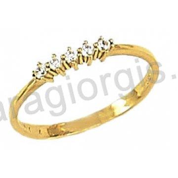 Δαχτυλίδι χρυσό 14 καράτια σε σειρέ με άσπρες πέτρες ζιργκόν.