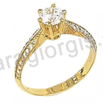 Μονόπετρο χρυσό με κεντρική πέτρα ζιργκόν σε αμερικάνικο τύπο με πλαϊνές πέτρες 14 καράτια.