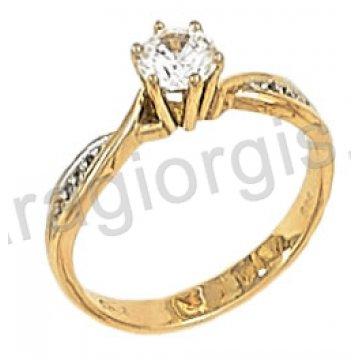 Μονόπετρο χρυσό με κεντρική πέτρα ζιργκόν με πλαϊνές πέτρες σε 14 καράτια.