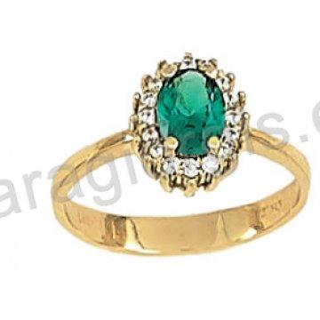 Δαχτυλίδι χρυσό σε ροζέτα με πράσινη πέτρα σε χρώμα σμαραγδί και περιμετρικές πέτρες ζιργκόν σε 14 καράτια.