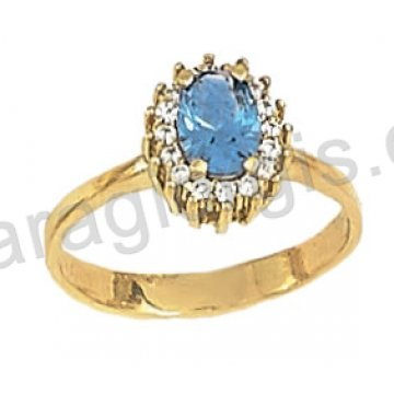Δαχτυλίδι χρυσό σε ροζέτα με γαλάζια πέτρα σε χρώμα άκουα μαρίνα και περιμετρικές πέτρες ζιργκόν σε 14 καράτια.