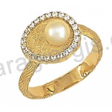 Δαχτυλίδι χρυσό fashion με άσπρη πέρλα σε 14 καράτια.