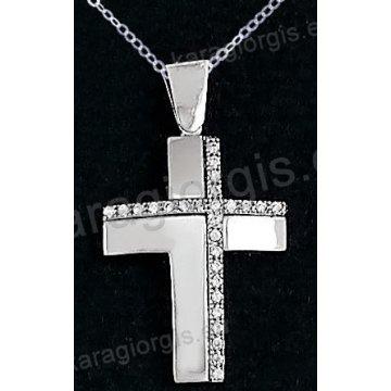 Βαπτιστικός σταυρός λευκόχρυσος για κορίτσι σε λουστρέ φινίρισμα με ένθετο σταυρό σε 14 καράτια με πέτρες ζιργκόν.