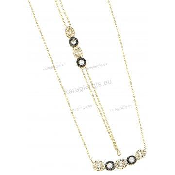 Σετ χρυσό σε Κ14 με κολιέ, βραχιόλι με στρογγυλές και οβάλ ροζέτες με άσπρες και μαύρες πέτρες ζιργκόν.