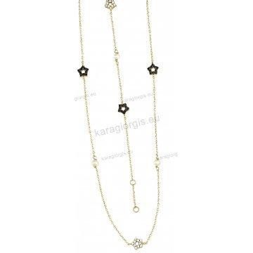 Σετ χρυσό σε Κ14 με κολιέ, βραχιόλι με περιμετρικά στοιχεία σε αστεράκια και πέρλες με άσπρες-μαύρες πέτρες ζιργκόν.