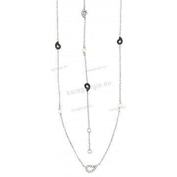 Σετ λευκόχρυσο σε Κ14 με κολιέ, βραχιόλι άσπρες πέρλες και περιμετρικά στοιχεία σε μαύρες και άσπρες πέτρες ζιργκόν.