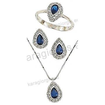 Σετ λευκόχρυσο σε Κ14 με κολιέ, σκουλαρίκια, δαχτυλίδι σε δάκρυ με μπλέ πέτρες ζιργκόν στο χρώμα του ζαφειριού.