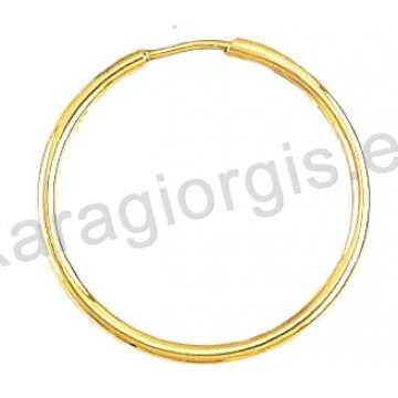 Κρίκοι χρυσοί Κ14 σε λουστρέ φινίρισμα διαμέτρου 2,30cm και πάχος 1,6mm.