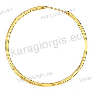 Κρίκοι χρυσοί Κ14 σε λουστρέ φινίρισμα διαμέτρου 3,70cm και πάχος 2,2mm.
