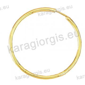 Κρίκοι χρυσοί Κ14 σε λουστρέ φινίρισμα διαμέτρου 3,30cm και πάχος 2,2mm.