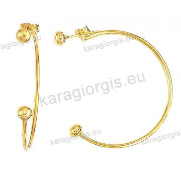 Κρίκοι χρυσοί Κ14 σε λουστρέ φινίρισμα με μπίλιες διαμέτρου 3,50cm.