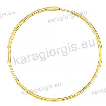 Κρίκοι χρυσοί Κ14 σε λουστρέ φινίρισμα διαμέτρου 3,70cm και πάχος 1,8mm.