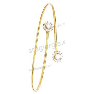 Χειροπέδα βραχιόλι χρυσό Κ14 γυναικείο με αντικριστές ροζέτες με πέτρες ζιργκόν.
